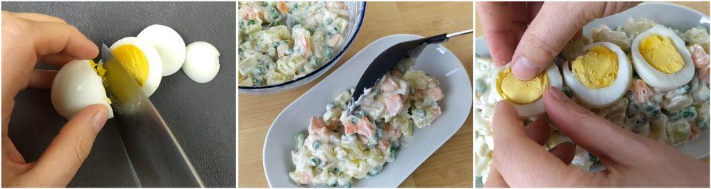 Decorare l'insalata russa con l'uovo sodo affettato